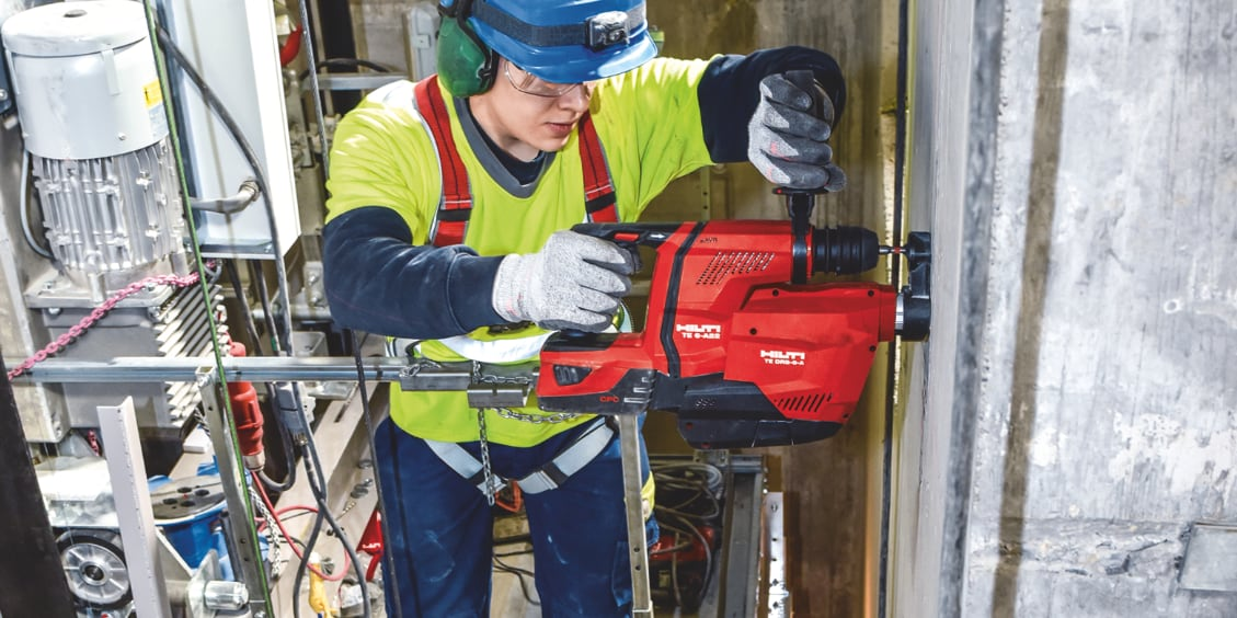 TE 6-A22 cordless rotary hammer being used with an integrated dust removal system